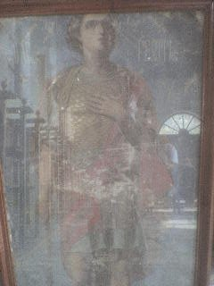 "<div align=""left""> Ολόσωμη φορητή εικόνα του Αγίου Γεωργίου. Χαρακτηριστική παρουσία του Αγίου με στολή ρωμαίου αξιωματικού.   </div>"